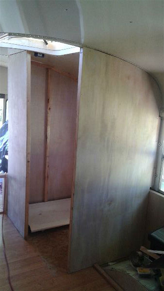 school bus conversion bathroom framing and paneling