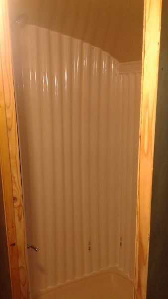 Tiny house shower stall caulked